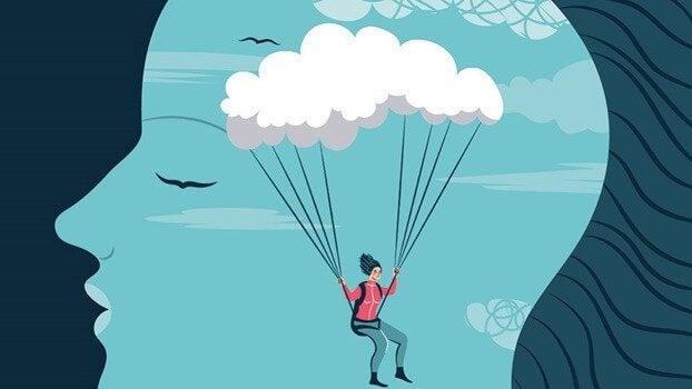 Silhouette eines Kopfes, in der ein Mensch an einer Wolke hängt