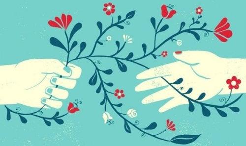Zeichnung zweier Hände, die Blumen halten