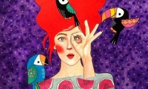 Frau mit Tropenvögeln