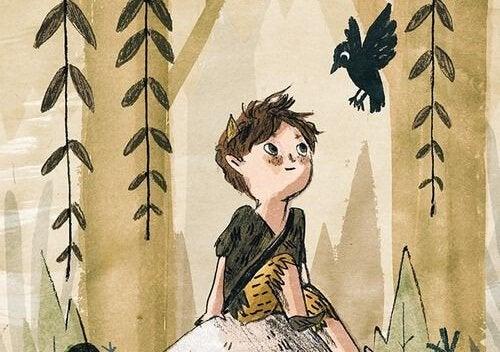 Junge schaut auf einen Raben