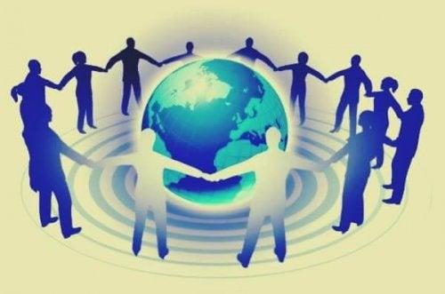Personen umschließen die Erde