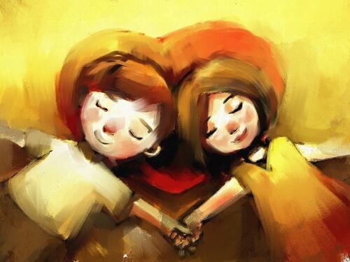 Paar hält Händchen und liegt dabei gemeinsam auf einem Herzkissen