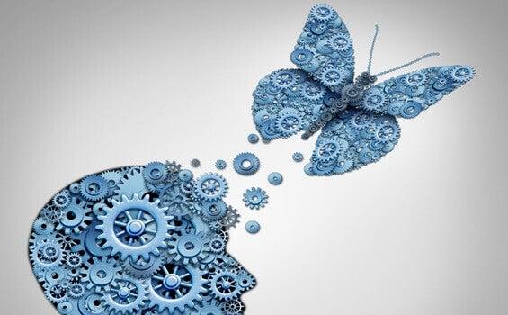 Kopf und Schmetterling aus Zahnrädern