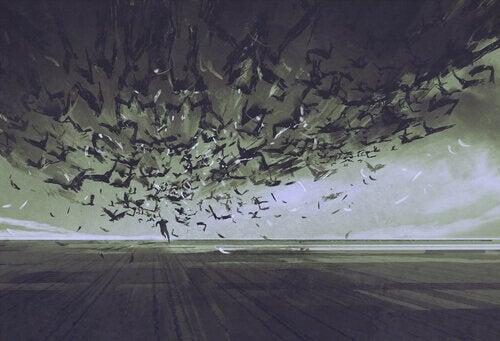 Ängstlicher Mann flieht vor Vogelschwarm