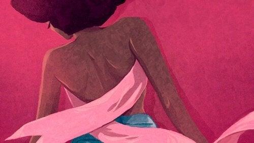 Frau mit rosa Schleife