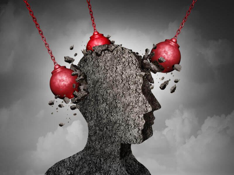 Silhouette eines Kopfes, die von Abrissbirnen getroffen wird