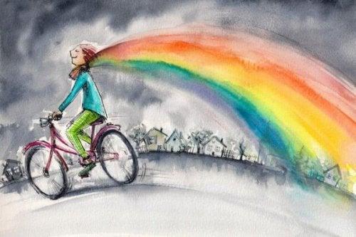 Mädchen mit Fahrrad und Regenbogen