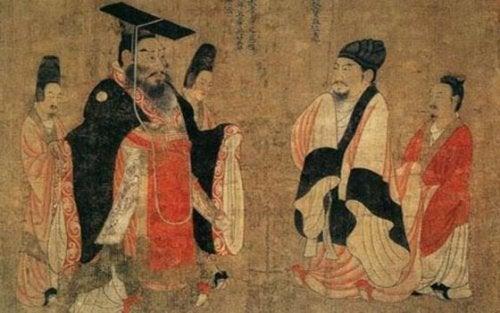 Zwei Männer unterhalten sich im Kreise ihrer Bediensteten.