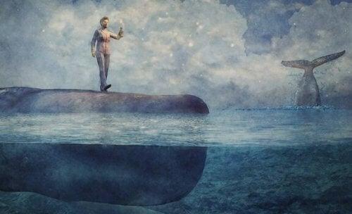 Ein surreales Bild, auf dem ein Mann auf einem Wal im Meer balanciert