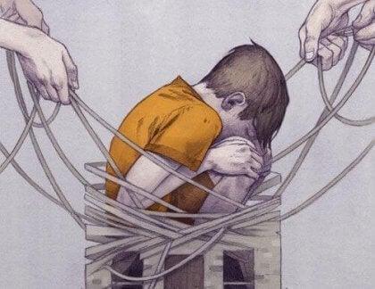 Ein Junge ist gefangen im Netz des Mobbings.