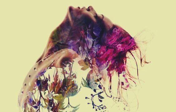 Ein Profil einer Frau, das sich scheinbar in Blumen auflöst