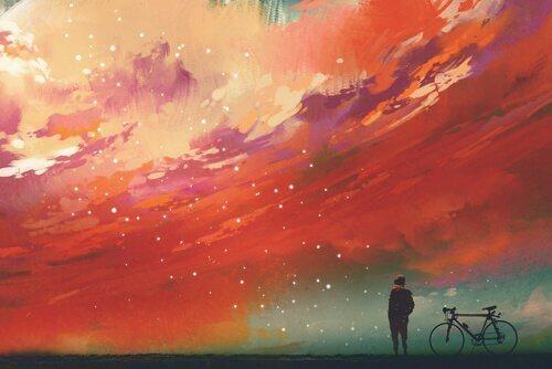 Roter Sternenhimmel, vor dem ein Mann mit seinem Fahrrad steht