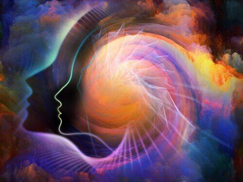 Eine Illustration, die verschiedene Konturen von Köpfen mit einer Spirale, bunt, Wolke im Hintergrund zeigt.