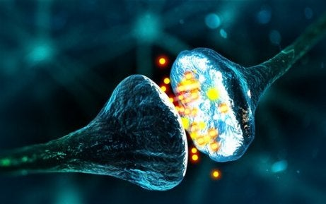 Eine digitale Illustration, die eine der Synapsenarten zeigt, bei der sich zwei Neuronen mit Partikeln verbinden, die zwischen ihnen ausgetauscht werden.