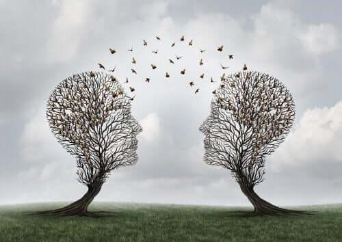 Zwei Bäume in Form von Köpfen, die die Psychologie der Sprache darstellen.