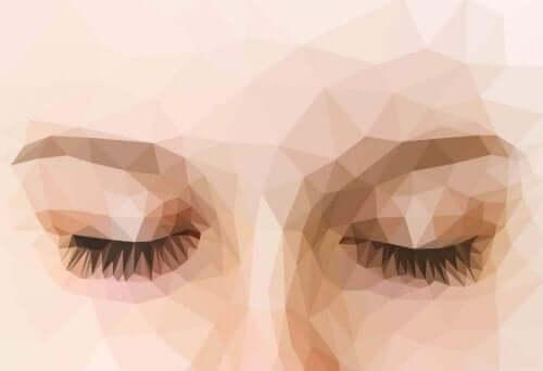 Ein pixeliges Bild der geschlossenen Augen einer Frau.